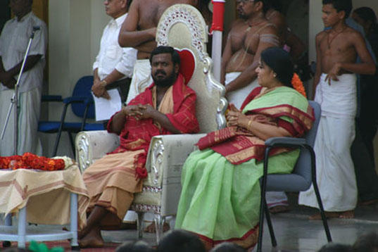 1 -Guest sits with Amma