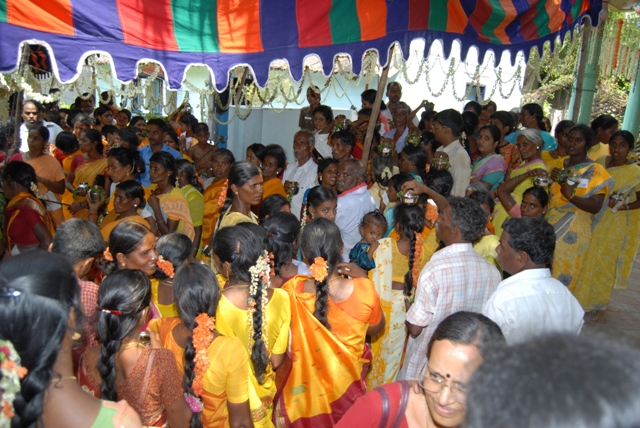 Devotees gathered in the shade waiting their turn