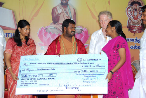 Amma gives a cheque for scholarships