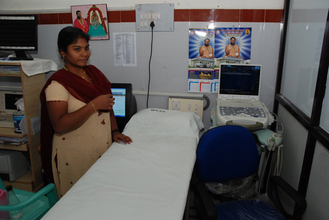 Hospital staff member shows off the machine