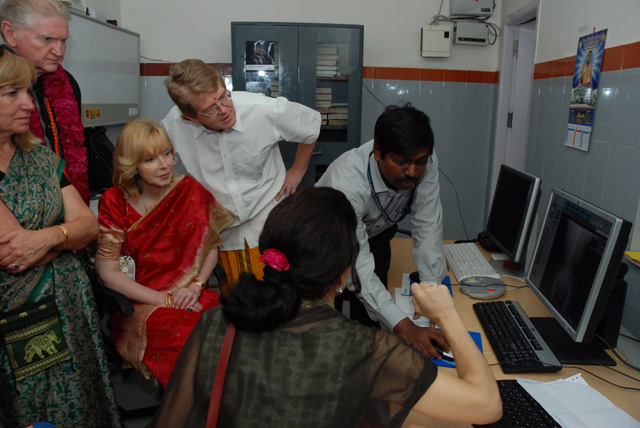 Hospital staff member shows off the computer