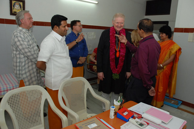 Hospital Doctor in discussion with overseas devotees
