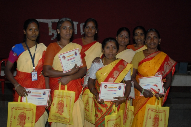 Guest House staff with their certificates of appreciation and bag of prasadham