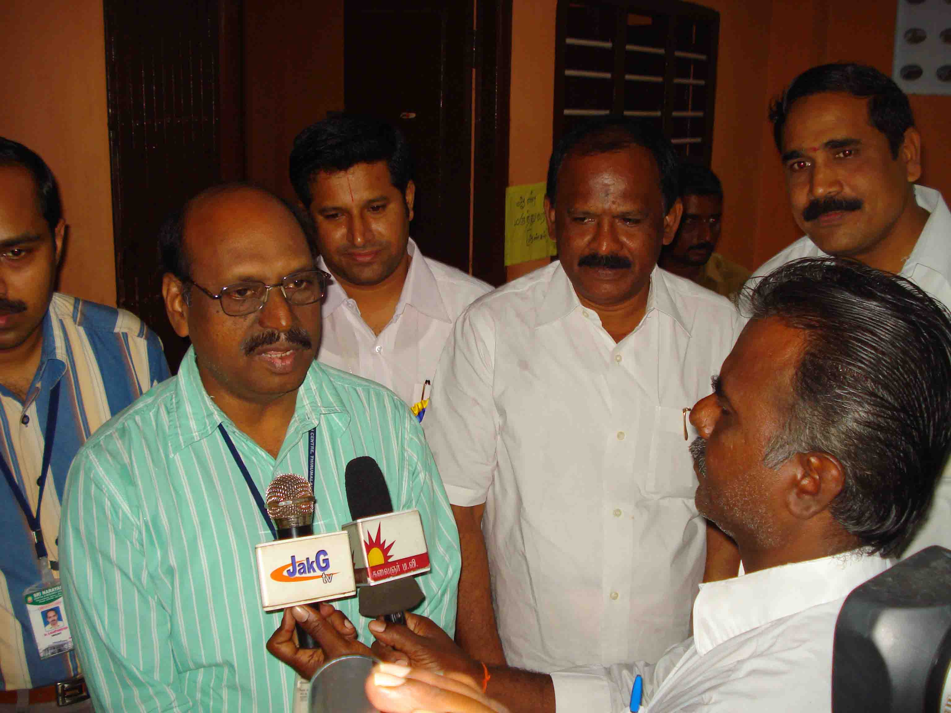 Dr. Varadhan speaks to the press on the services that are provided through the Medical Camps