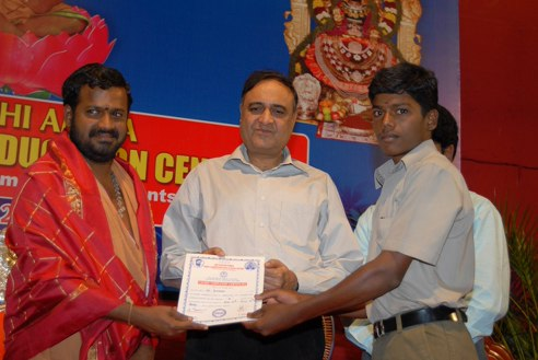 The Vellore District Collector presents a certificate to a graduate