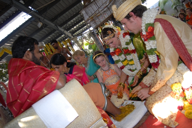 The couple does Pada Puja