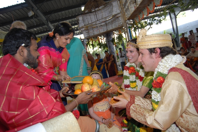 Mr. & Mrs. Ben Lee gives an offering to Amma