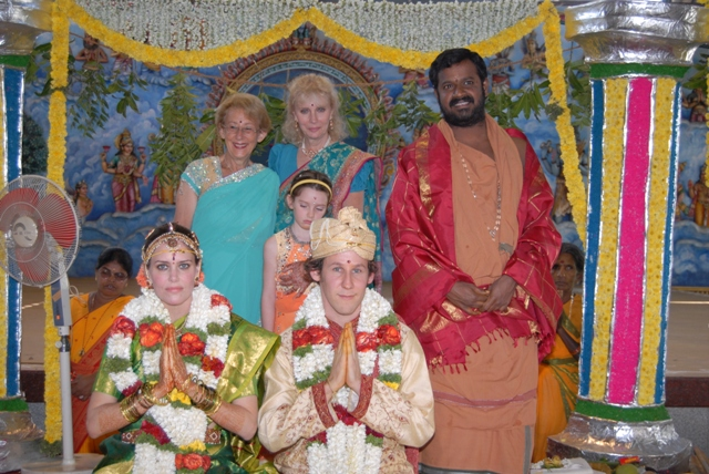 Family members and newly married couple with Beloved Amma
