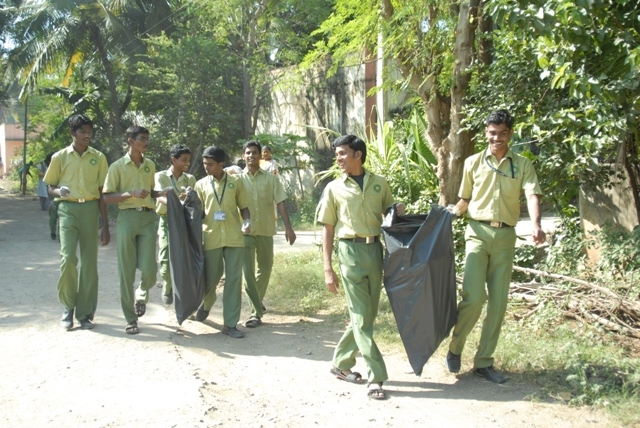 Students work together to clean up the environment