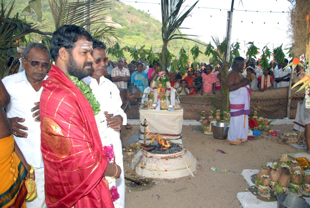 Sri Sakthi Amma is garlanded by the temple officials