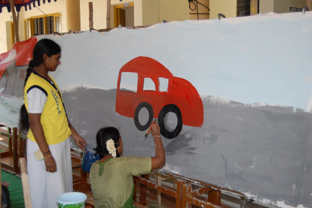 Student artist paints a car