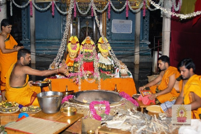 Priests conduct the Yagam