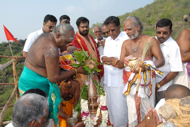 Special kumbha abhishekam at the top of the temple