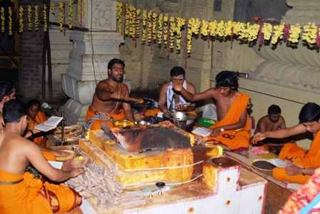 Priests conduct the puja at the Sripuram