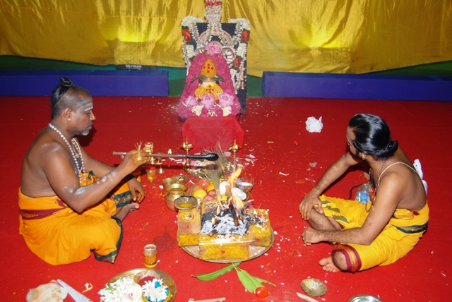 Temple priests chant the mantras