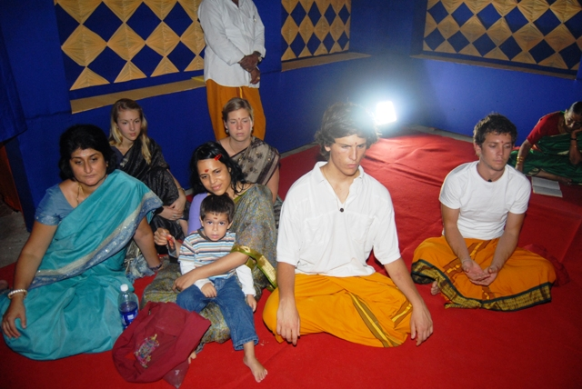 Devotees attend the homam