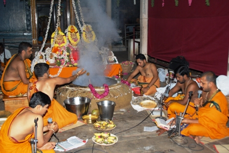 Priests conduct the puja at the Peedam