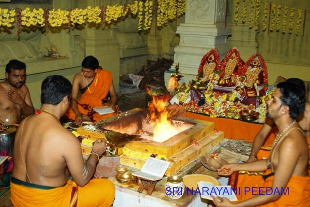 Priests conduct the Yagam at the Sripuram