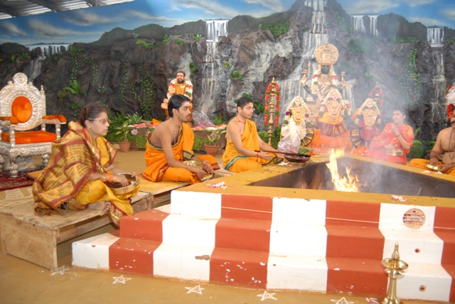Everyone adds offerings into the fire with the chanting of the mantras