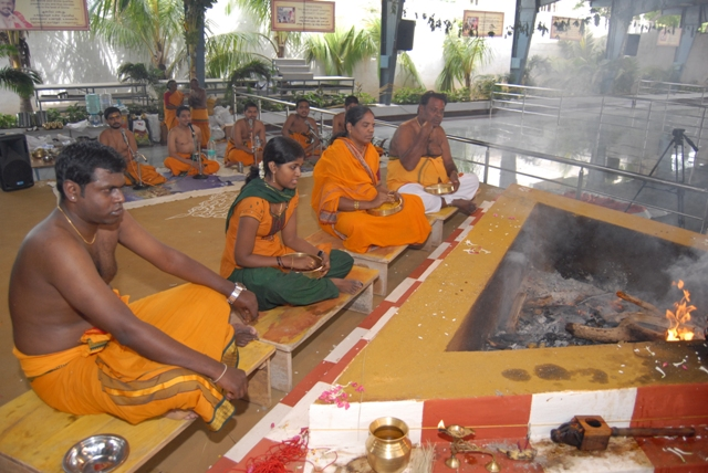 Families sit for the homam