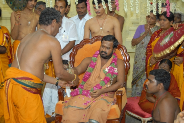 Amma blesses an offering