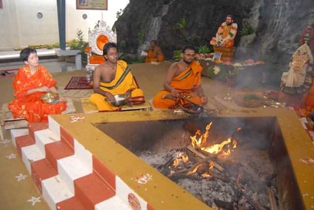 Priests conduct the homam