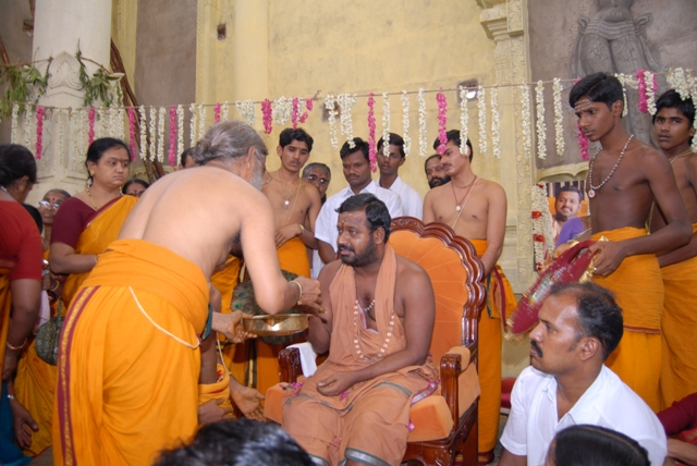 Beloved Amma blesses an offering