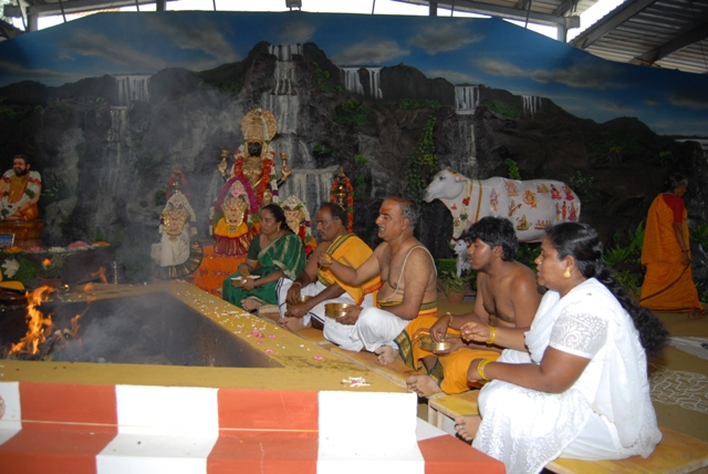 Families sit together for the homam