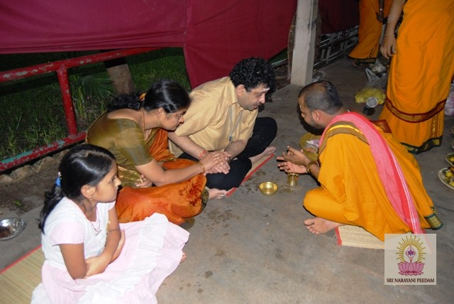 Ayurvedic Doctor and family participate in the Yagam