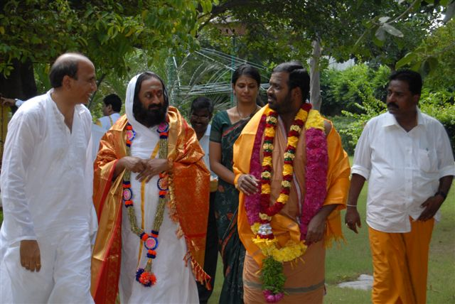 Beloved Amma with Guruji and other guests