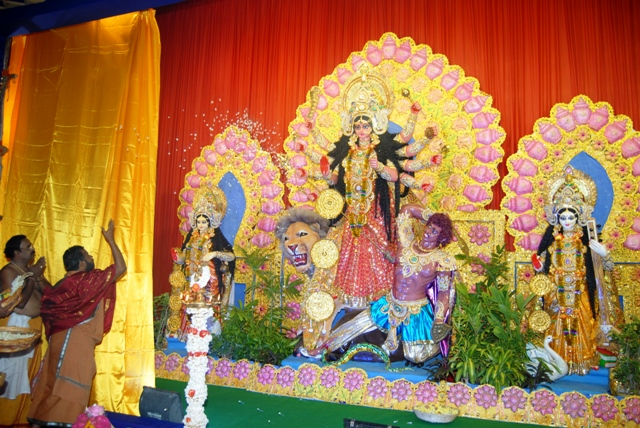 Beloved Amma opens the curtain unveiling Goddess Durga