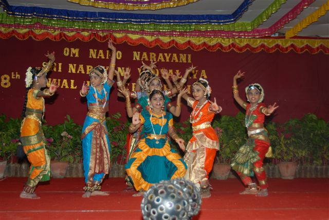 Female students perform a dance