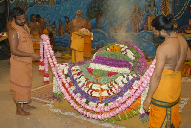 Beloved Amma adds the Lotus garlands