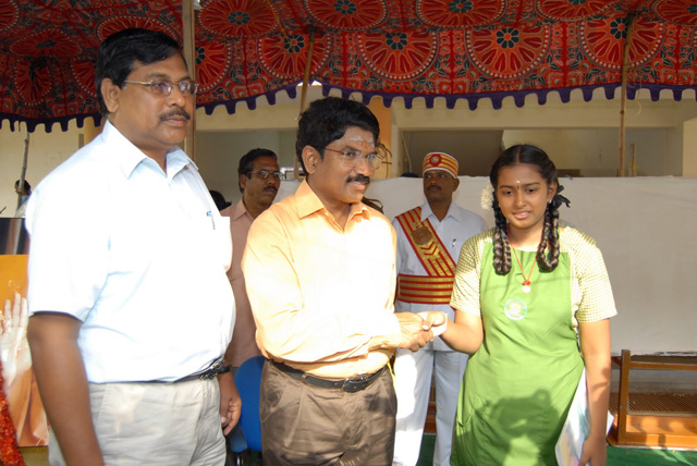 Chief Guest congratulates the student (J. Mithra)