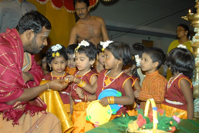 Beloved Amma gives a token to the young performers
