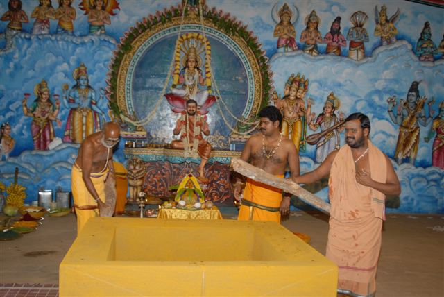 Sri Sakthi Amma adds the first log to start the Yagam