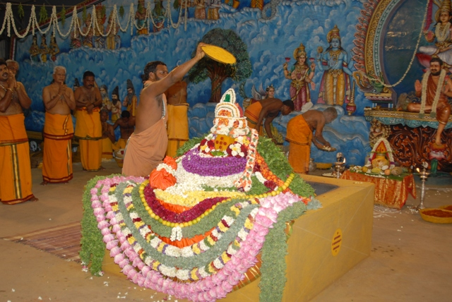 Sri Sakthi Amma adds an offering into the fire