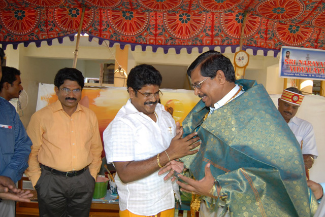 Mr. Suresh Babu presents a shawl to the Chief Guest
