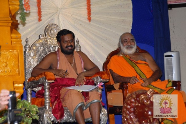 Sri Sakthi Amma and Guest Priest look on at the dance performances