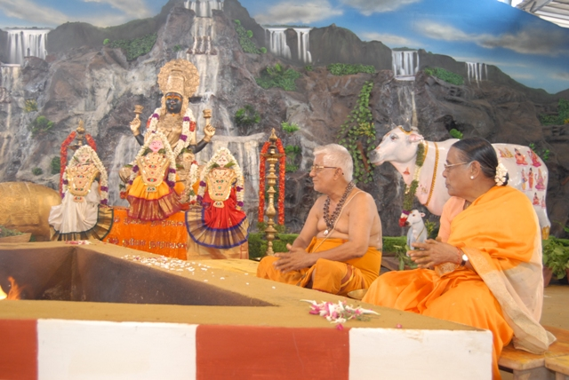 Family sits for the homam