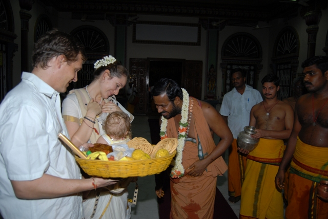 Beloved Amma plays with the baby of the overseas devotees