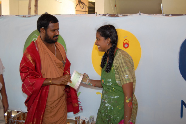 Beloved Amma presents a cheque to one of the artists