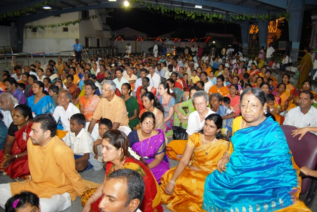 Smt. Jothiamma sits in the audience