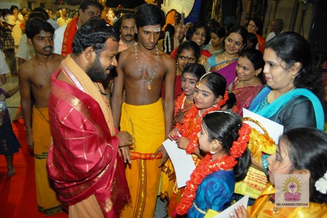 Beloved Amma speaks to the young performers after the program