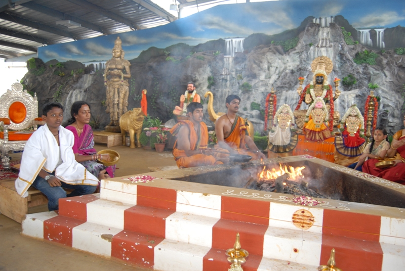 Priests perform the homam