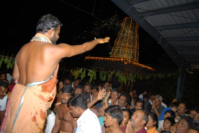 Beloved Amma blesses the gathering with holy water