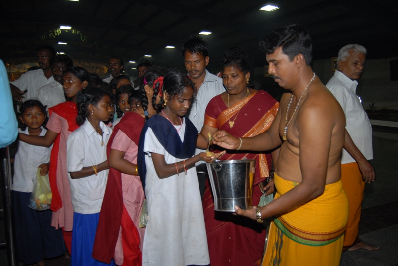 Everyone receives prasadham