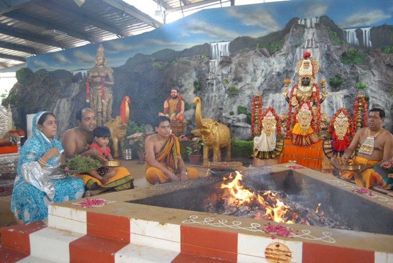 Families participate in the homam