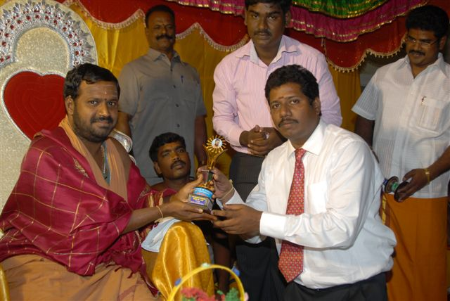 Chief Guest receive a token from Beloved Amma