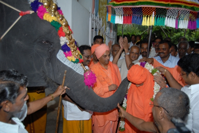 The temple elephant blesses the Swamiji